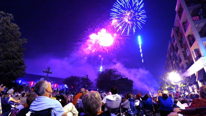 Second and Main streets are filled as people gather to watch the fireworks display at the conclusion of the Stars & Stripes concert July 4, 2013, in Riehle Plaza.