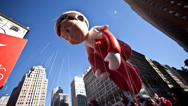 He's watching, even at the parade. The Elf on a Shelf balloon floats above the street during the Macy's Thanksgiving Day Parade on Nov. 28 in New York City.