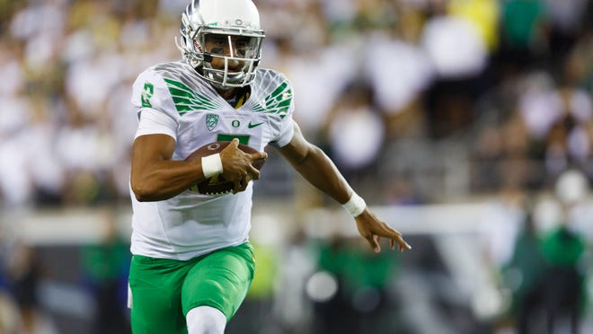 Oregon quarterback Marcus Mariota (8) runs with the football during the second quarter of an NCAA college football game in Eugene, Ore., Saturday, Aug. 30, 2014 (AP Photo/Ryan Kang)