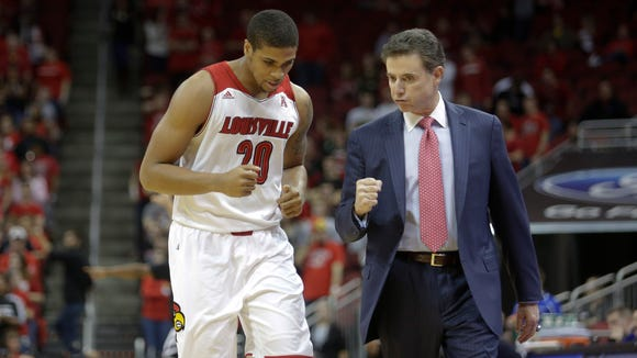 Louisville coach Rick Pitino urges on Wayne Blackshear.