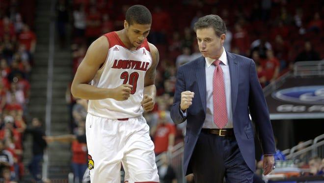 Louisville coach Rick Pitino urges on Wayne Blackshear.