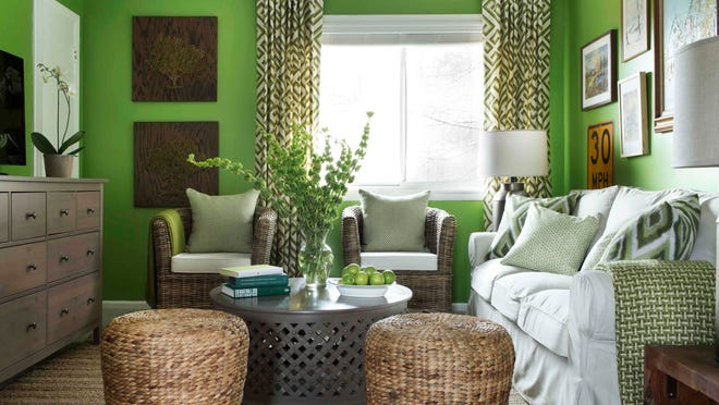 This photo provided by Brian Patrick Flynn/HGTV.com shows a living room designed for Dwell with Dignity by Flynn where he uses neutral accents to tone down the highly energetic tone of apple green wall paint. (AP Photo/Brian Patrick Flynn/HGTV.com, Sarah Dorio)
