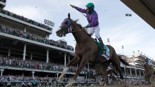 California Chrome, here winning the 2014 Kentucky Derby, is based out of Los Alamitos, which gained a Derby points race leading up to the 2015 running.