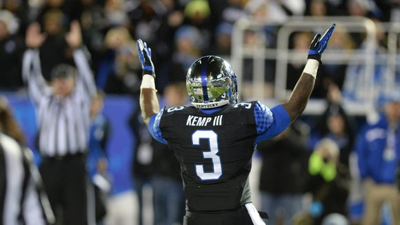 UK RB Jojo Kemp celebrates after a touchdown during the first half against South Carolina. October 4, 2014.