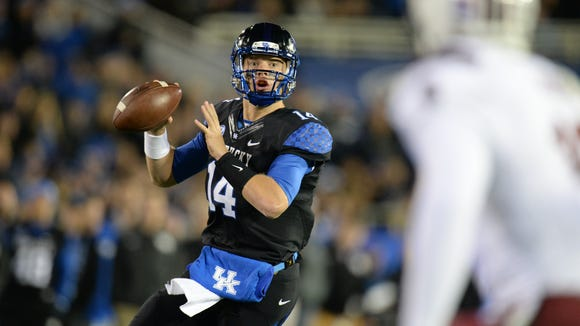 UK QB Patrick Towles scrambles during the first half of the University of Kentucky Wildcats Football game against the South Carolina Gamecocks in Lexington, KY. Saturday, October 4, 2014.