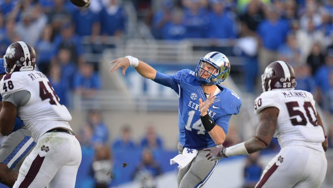 UK quarterback Patrick Towles thows the ball during the second half of the University of Kentucky football game against Mississippi State in Lexington, Ky. Saturday, October 25, 2014.