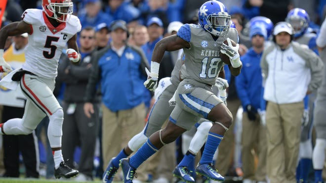 UK running back, Boom Williams, scores on a 56 yard run during the University of Kentucky football game against the University of Georgia at Commonwealth Stadium in Lexington, Ky. Saturday, November 8, 2014.