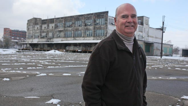 Architect and developer Bill Weyland standing in front of an abandoned LG&E building near Old Louisville.