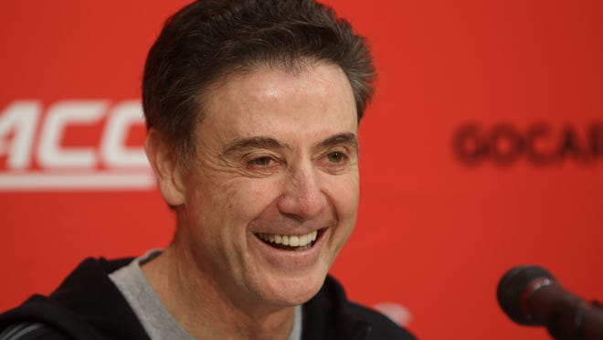 Louisville coach Rick Pitino smiles as he jokes with reporters during his weekly press conference. December 1, 2014