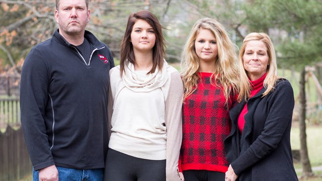 From left are Dan English with his daughters Sydney and Nicole, and their mother Dina English-Shawn at their home in Louisville.