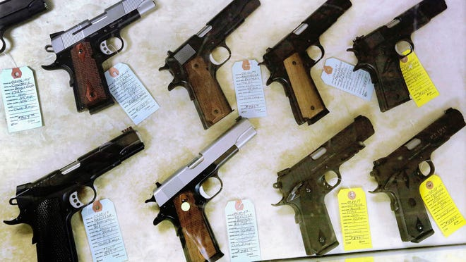 A file photo of guns confiscated by police.