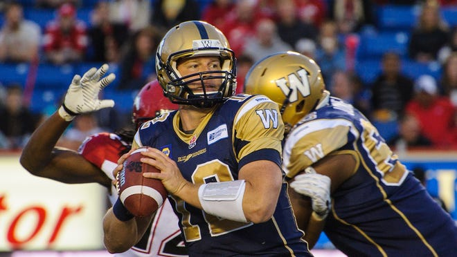 Brian Brohm looks for a teammate to pass to during a CFL game against the Calgary Stampeders at McMahon Stadium on June 14, 2014 in Calgary, Alberta, Canada.