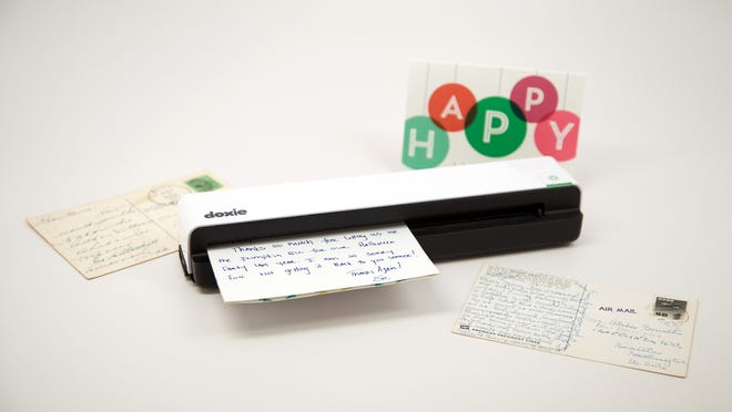 Doxie's latest portable scanner can scan documents to a computer or send documents directly to an iPhone or iPad with the new iOS app.