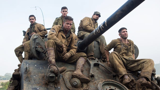 """This photo released by Sony Pictures Entertainment shows, from left, Shia LaBeouf as Boyd """"Bible"""" Swan, Logan Lerman as Norman, Brad Pitt as Sgt. Don """"Wardaddy"""" Collier, Michael Pena as Trini """"Gordo"""" Garcia, and Jon Bernthal as Grady """"Coon-Ass"""" Travis, in Columbia Pictures' """"Fury."""" (AP Photo/Sony Pictures Entertainment, Giles Keyte)"""