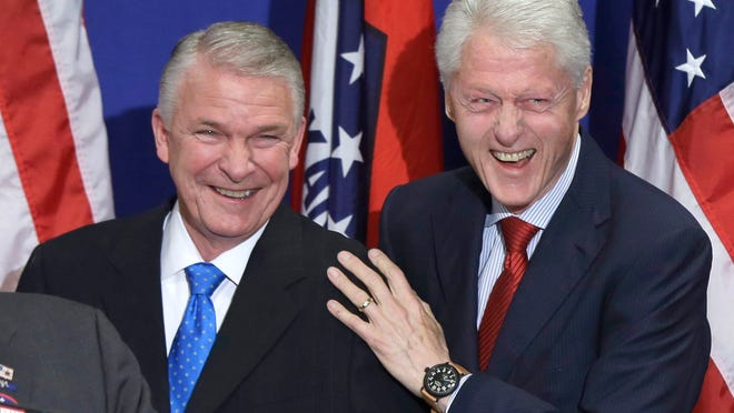 In this April 5 photo, former President Bill Clinton (right) and former Federal Emergency Management Agency Director and congressional candidate James Lee Witt greet a crowd at a political fundraiser in Hot Springs. Arkansas Democratic Party officials announced Mondaythat Clinton will headline a series of rallies for Arkansas Democrats next week.