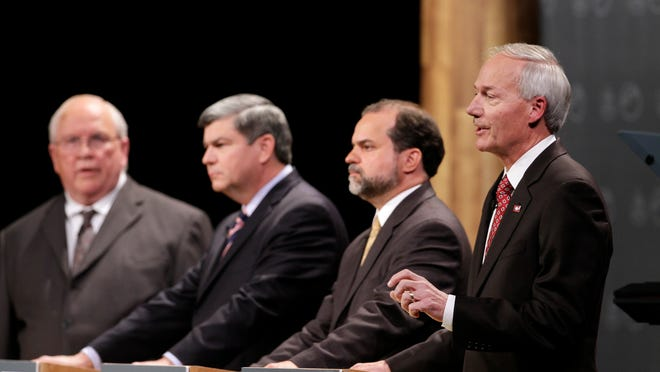 Asa Hutchinson (from right) Joshua Drake, Mike Ross and Frank Gilbert participate in a debate between   candidates .