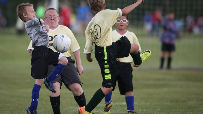 Players for Bergstrom Chevrolet and Murdock DQ compete in a U12 Boys game at Soccer Saturday.