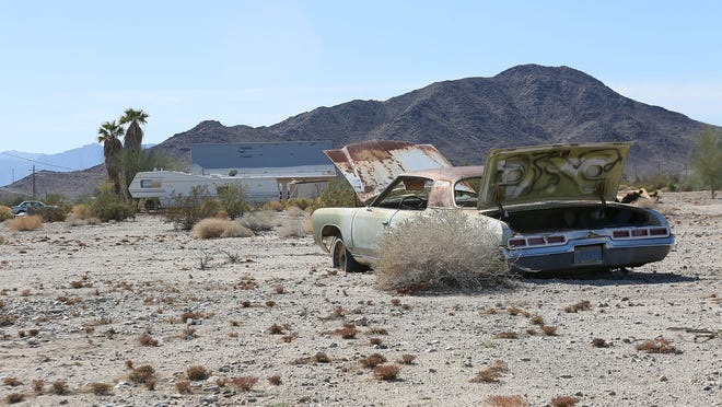 """An old car rusts away on private land near Desert Center, in eastern Riverside County. This area would become part of a renewable energy zone under the Desert Renewable Energy Conservation Plan's """"Preferred Alternative."""""""