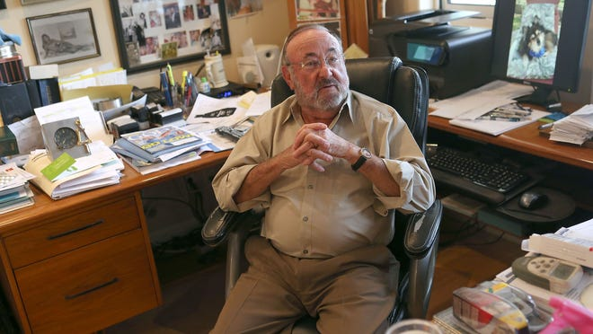 Palm Springs attorney Martin Berman sits in his home office.