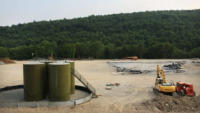 Earth-moving equipment and natural gas containers are viewed at a hydraulic fracturing site in South Montrose, Pennsylvania. While New York has yet to decide whether to allow fracking, the courts are hearing cases about how much input localities may have on the issue.
