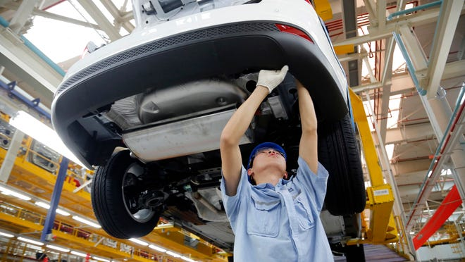 By 2020, Ford Motor Co. hopes Asia Pacific and the Middle East will account for one-third of its sales. A worker in 2013 assembles a vehicle at a factory in Chongqing China.