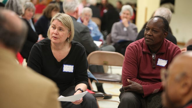 Ida Holloran of Irondequoit, left, and James McClary of Rochester engage in discussions on race relations at a Facing Race, Embracing Equity forum in 2013 at the Asbury Methodist Church.