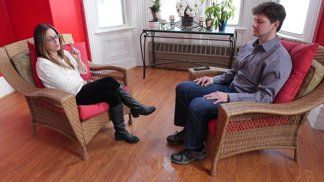 Geneva medium Beth Lynch begins a session with Democrat and Chronicle reporter David Andreatta at a yoga studio within the city limits of Geneva. This was believed to be the first legal psychic reading in the city of Geneva in 47 years.