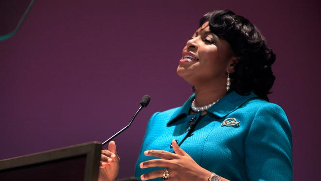 Mayor Lovely Warren addresses the crowd at the Auditorium Theatre during her public inaugural ceremony in 2014.