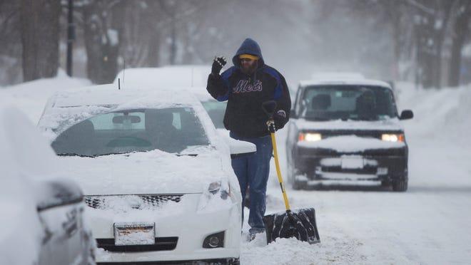 Sean Conlon helps his friend dig his car out on Feb. 15, 2015.
