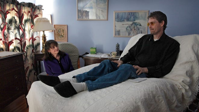 Janet Vieau, left, sits with her son Jeff Lill at her Irondequoit home in 2013.