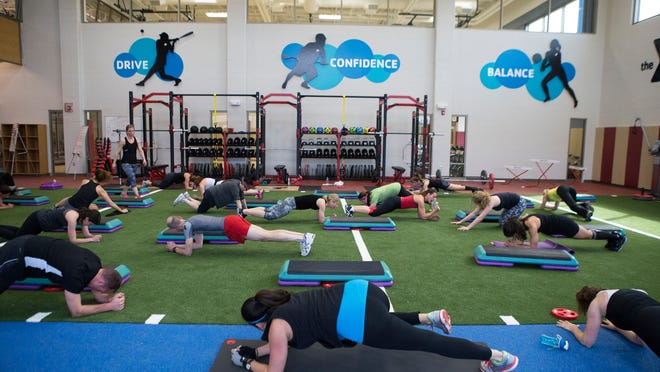 Members participate in a GRIT class in the Sports Performance Center in the new expansion at the Eastside Family Branch YMCA in Penfield on Saturday.