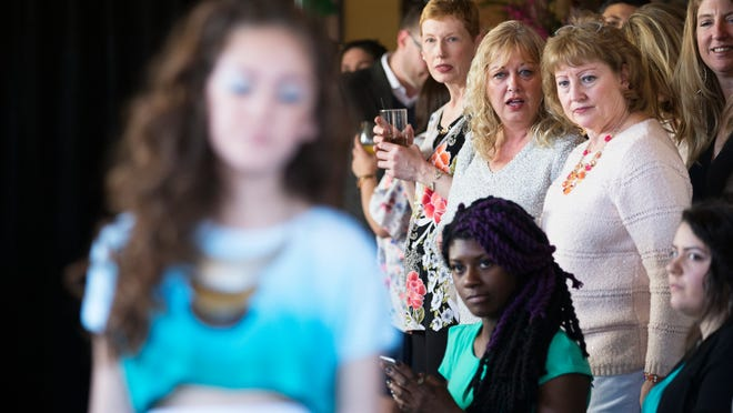 Sisters Wendy and Nancy Elliot watch as a model walks down the runway modeling the Josean Vargas collection at the Peppermint Sewn Seeds runway show at Good Luck on Sunday, March 29, 2015.