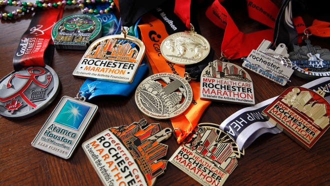 These are just some of the marathon medals Bethany Snyder, an avid walker, has won. She is the founder of the blog BigFitDeal.