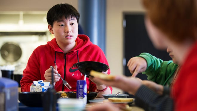 Seventh-grader Zach Nam serves himself couscous during lunch at Allendale Columbia School this month.
