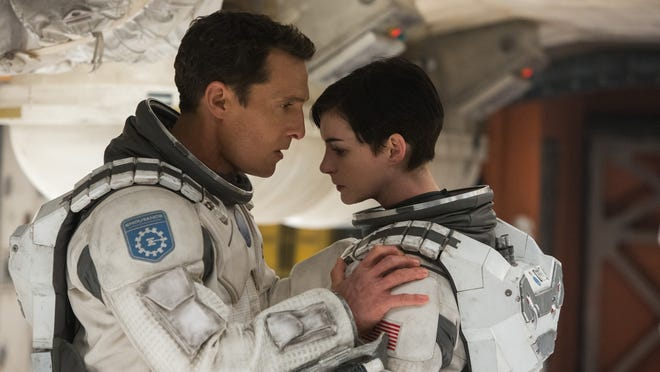 "Matthew McConaughey and Anne Hathaway star in ""Interstellar."""