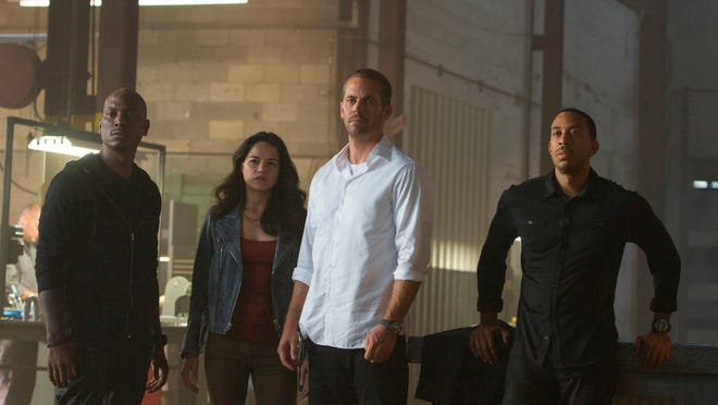 """Tyrese Gibson (from left), Michelle Rodriguez, Paul Walker and Chris Ludacris star in """"Furious 7."""""""