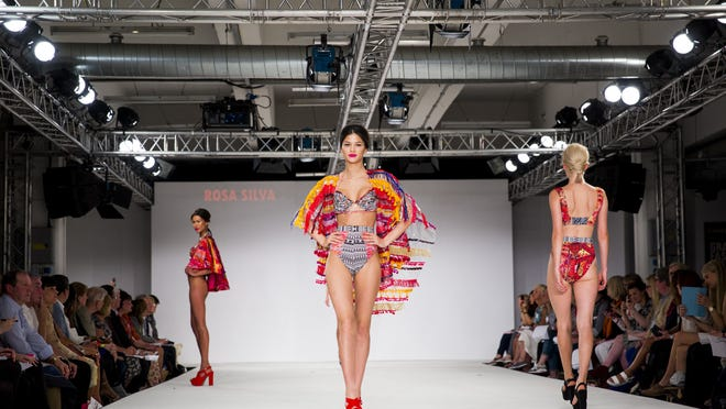 Models walk the runway wearing designs by Rosa Silva during the De Montfort Contour show during day 2 of Graduate Fashion Week 2014 at The Old Truman Brewery on June 1, 2014 in London, England.
