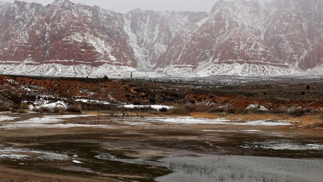 Snow dusts the red cliffs north of the Shivwits Paiute Indian Reservation after a storm.