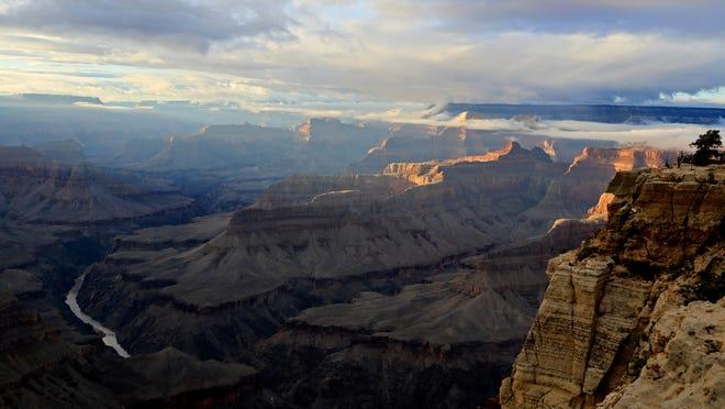 The Colorado River flows through the Grand Canyon.