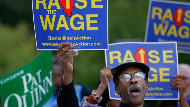 Supporters of raising the minimum wage rally in Peoria, Ill., on Oct. 9.