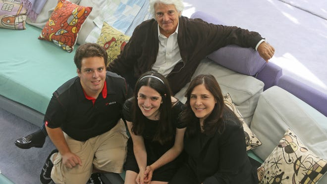 """Mitchell Cannold and Dori Berinstein of Mount Kisco are both nominated for Emmys in the same category: Outstanding Documentary Or Nonfiction Series. Mitchell was executive producer of """"Cosmos: A SpaceTime Odyssey."""" Dori for """"Marvin Hamlisch: What He Did for Love."""" They were photographed Aug. 14, 2014 with their children Sammi, 20, and Noah, 17."""