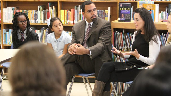 New York State Education Commissioner John King listens to ESL teacher Shawna Squillace as he speaks with educators following a tour of JFK Magnet Elementary School in Port Chester Oct. 10, 2013.