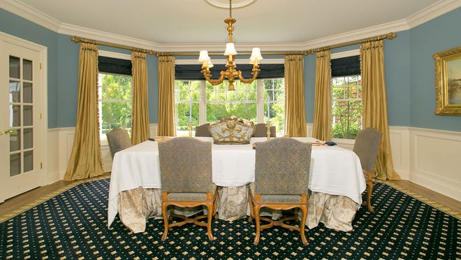 This home in Bedford has a formal dining room. Long a fixture in houses large and small, the dining room may be repurposed, but homebuyers still want the space.