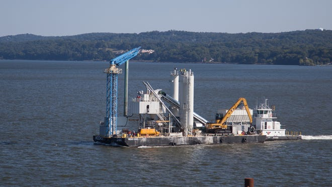 One of the project's floating concrete plants, before one collapsed and the other was taken out of service.