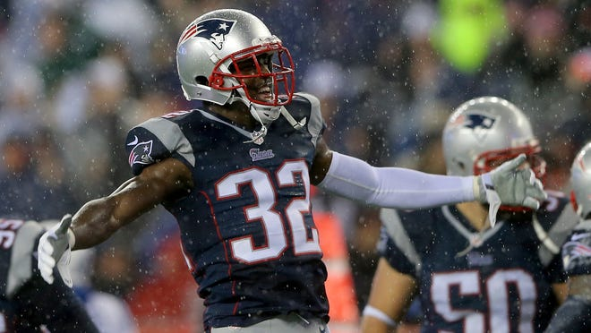 Devin McCourty (32) of the New England Patriots celebrates in the second half against the Indianapolis Colts of the 2015 AFC Championship Game at Gillette Stadium on January 18, 2015 in Foxboro, Massachusetts.