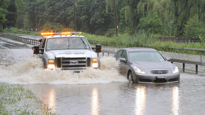 A flash flood on the Taconic State Parkway shown in a file photo. Activists say climate change is leading to extreme weather events and could exacerbate flood conditions.