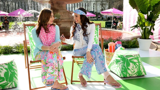 Models pose during the Lilly Pulitzer For Target Pop-up Shop Activation at Bryant Park Grill in New York City.