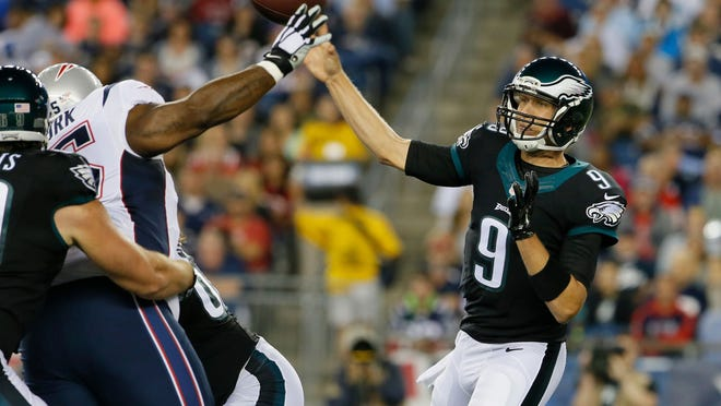 Eagles quarterback Nick Foles throws a pass during a preseason game against the Patriots on Friday at Gillette Stadium.