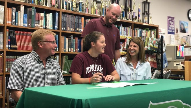 Wall's Anna Pickett signs her letter of intent to run track for McMurry University Tuesday, May, 15, 2018, in the Wall High School library.
