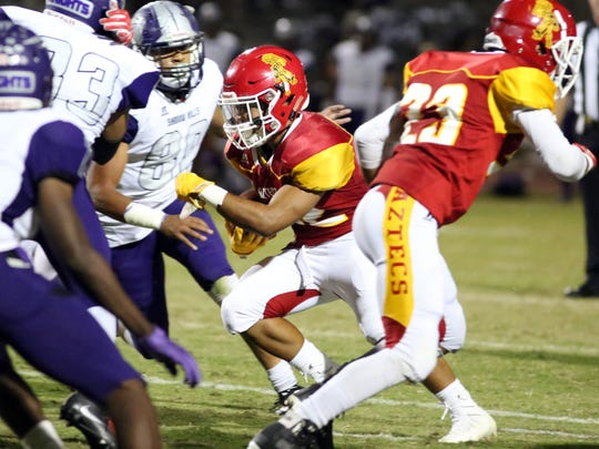 Palm Desert's Manny Sepulveda carries the ball for a touchdown against Shadow Hills in the 1st quarter on Friday, September 29, 2017 in Palm Desert.